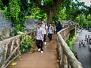 17 AUGUST 2018 - BANGKOK, THAILAND:   School boys walk through Dusit Zoo. Dusit Zoo, Bangkok's oldest public zoo, opened in 1938. The zoo grounds were originally the Dusit Royal Garden. The zoo is scheduled to close by the end of August 2018 because it is being relocated to Nakhon Pathom province, south of Bangkok.      PHOTO BY JACK KURTZ