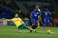 Sol Bamba of Cardiff City goes past a tackle from Mario Vrancic of Norwich city (l).EFL Skybet championship match, Cardiff city v Norwich city at the Cardiff city stadium in Cardiff, South Wales on Friday 1st December 2017.<br /> pic by Andrew Orchard, Andrew Orchard sports photography.