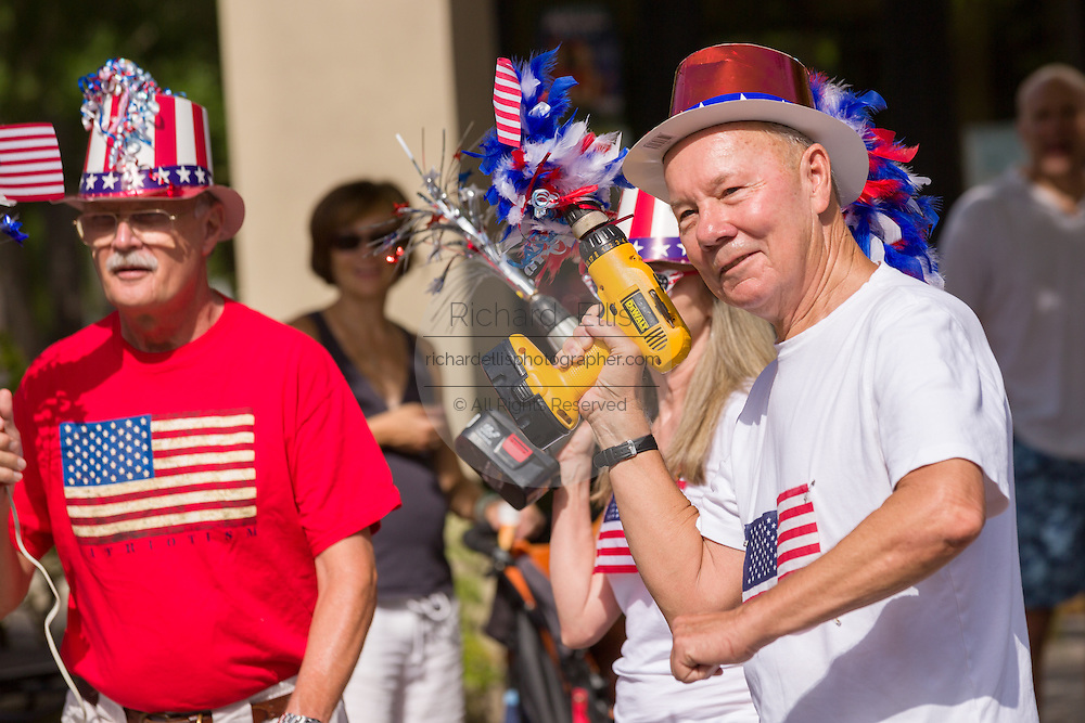 """Members of the """"Precision Drill Team"""" perform during the I'On neighborhood Independence Day parade July 4, 2015 in Mt Pleasant, South Carolina. The team parades using battery operated drills as their novelty."""