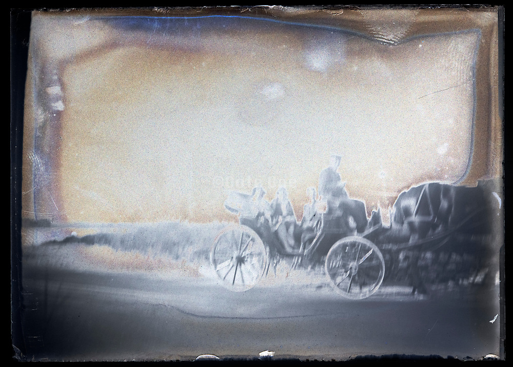 extreme deteriorated glass plate of horse driven carriage with people