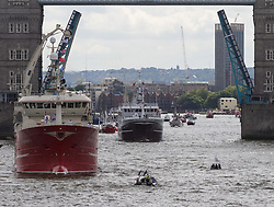 """London Bridge, London, June 15th 2016. A flotilla of fishing boats led by UKIP's Nigel Farage heads through Tower Bridge in protest against the EU's Common Fisheries Policy and in support of Britain leaving the EU. PICTURED: Small boats from the """"remain"""" campaign disrupt the flotilla."""