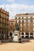 A man waits in Placa Independencia girona, Girona, Catalonia, Spain