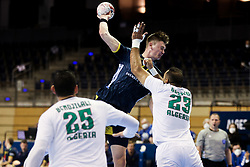 Oskar Sunnefeldt of Sweden vs Berriah Abderahim of Algeria during handball match between National Teams of Sweden and Algeria at Day 2 of IHF Men's Tokyo Olympic  Qualification tournament, on March 13, 2021 in Max-Schmeling-Halle, Berlin, Germany. Photo by Vid Ponikvar / Sportida