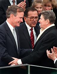 President Ronald Reagan greets newly-inaugurated president George H.W. Bush during Bush's swearing-in ceremony, January 20, 1989, in Washington, DC. Photo by Joe Burbank/Orlando Sentinel/MCT/ABACAPRESS.COM