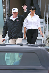 August 29, 2017 - Corpus Christi, Texas, U.S. - US President DONALD TRUMP (R) and First Lady MELANIA TRUMP arrive at the Corpus Christi International Airport. Trump travelled to Texas on Tuesday to see the recovery efforts underway in the aftermath of Hurricane Harvey. (Credit Image: © Tom Reel/San Antonio Express-News via ZUMA Wire)