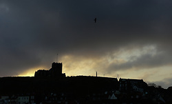 © Licensed to London News Pictures. <br /> 15/03/2015. <br /> <br /> Whitby, United Kingdom<br /> <br /> First light behind St Mary's church in Whitby in North Yorkshire.<br /> <br /> Photo credit : Ian Forsyth/LNP