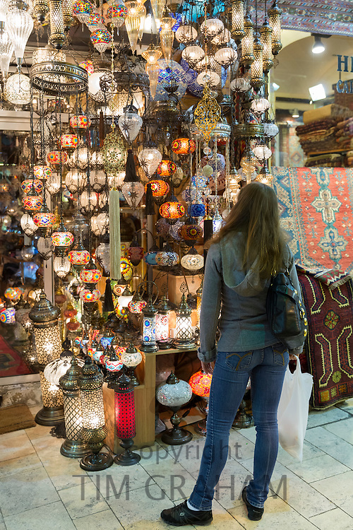 Western tourist shopping inside The Grand Bazaar, Kapalicarsi, great market in Beyazi, Istanbul, Republic of Turkey