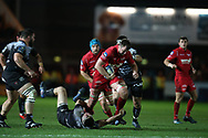 David Bulbring of the Scarlets © barges over Toulon players as he breaks towards the try line.  EPCR European Champions cup match, Scarlets v RC Toulon at the Parc y Scarlets in Llanelli, West Wales on Saturday 20th January 2018. <br /> pic by  Andrew Orchard, Andrew Orchard sports photography.