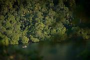 View of Canoe on McClaren Fjord, Tufi, Cape Nelson, Oro Province, Papua New Guinea