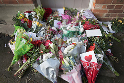 © Licensed to London News Pictures. 26/12/2016. Goring-, UK. Fans floral tributes cover the step at the door of George Michael's house in Goring. Pop superstar George Michael died on Christmas day at his Oxfordshire home on the River Thames aged 53. Photo credit: Peter Macdiarmid/LNP