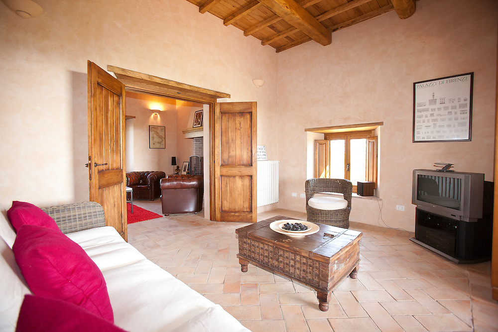 Villa San Donato in Italy, on the border between Tuscany and Lazio. The sitting room/media room.