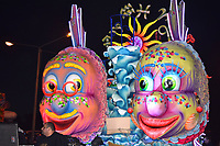 Two fishes on carnival float at night illuminated