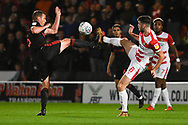Fully committed challenge from Lee Cattermole of Sunderland (6) and Ben Whiteman of Doncaster Rovers (8) during the EFL Sky Bet League 1 match between Doncaster Rovers and Sunderland at the Keepmoat Stadium, Doncaster, England on 23 October 2018.