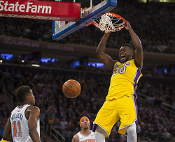 December 12, 2017 - Manhattan, NY, USA - The Los Angeles Lakers' Julius Randle (30) dunks against the New York Knicks at Madison Square Garden in New York on Tuesday, Dec. 12, 2017. The Knicks won, 113-109, in overtime. (Credit Image: © Howard Simmons/TNS via ZUMA Wire)