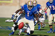 Nov 17, 2012; Tulsa, OK, USA; University of Central Florida Knights defensive back Brandon Alexander (37) breaks up a pass intended for Tulsa Hurricanes Keyarris Garrett (1) during a game at Skelly Field at H.A. Chapman Stadium. Tulsa defeated UCF 23-21.Mandatory Credit: Beth Hall-US PRESSWIRE