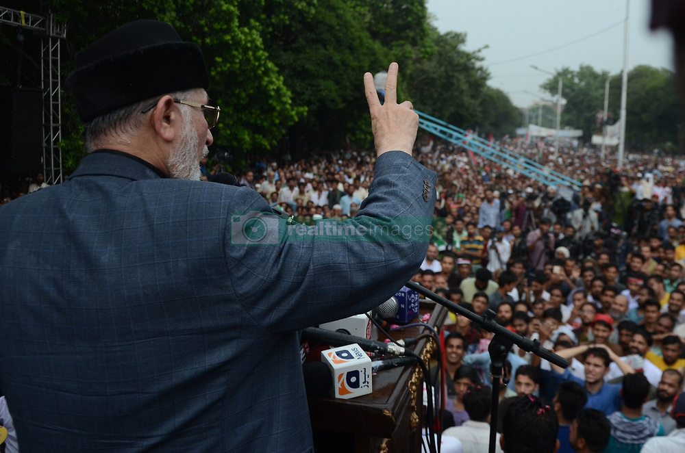 August 9, 2017 - Lahore, Punjab, Pakistan - Dr Tahir ul-Qadri, Sufi cleric and leader of political party Pakistan Awami Tehreek (PAT), speaks to his supporters during public gathering meeting in Lahore on August 08,2017. To spearhead a campaign against the incumbent government and demand justice for martyrs of Model Town tragedy. (Credit Image: © Rana Sajid Hussain/Pacific Press via ZUMA Wire)