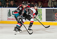 KELOWNA, CANADA - OCTOBER 18: Tyrell Goulbourne #12 of the Kelowna Rockets is checked by Chase Witala #14 of the Prince George Cougars on the ice as the Prince George Cougars visit the Kelowna Rockets on October 18, 2012 at Prospera Place in Kelowna, British Columbia, Canada (Photo by Marissa Baecker/Shoot the Breeze) *** Local Caption ***