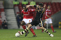 Photo: Pete Lorence.<br />Nottingham Forest v Charlton Athletic. The FA Cup. 06/01/2007.<br />Wesley Morgan battles with Darren Ambrose.