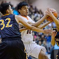 Wingate Bear David Juan (10) charges through the Navajo Prep Eagles defense Saturday at Gallup High School.
