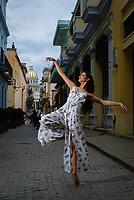HAVANA, CUBA - CIRCA JANUARY 2020: Ballerina in  the streets of Havana, with Capitol building behind.