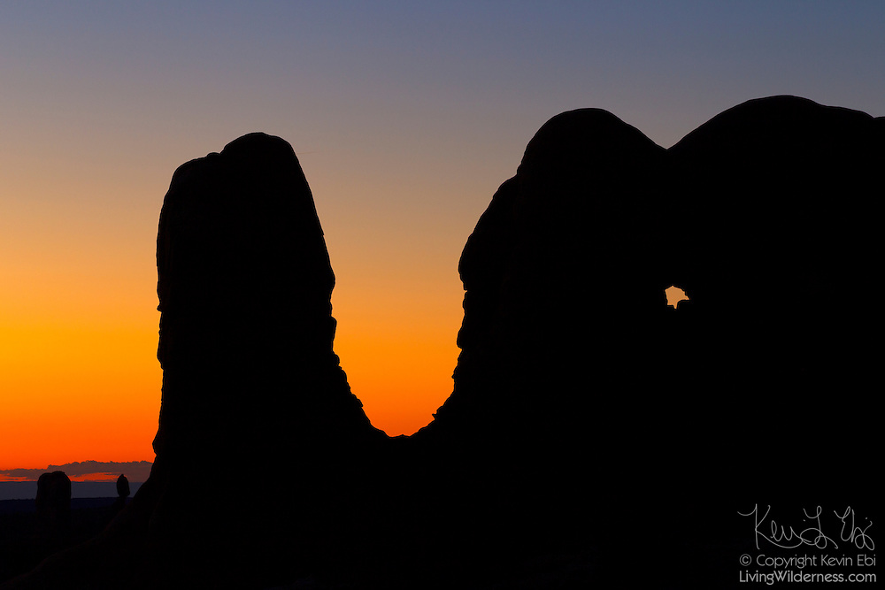 A formation that is part of the Parade of Elephants is rendered in silhouette after sunset in Arches National Park, Utah.