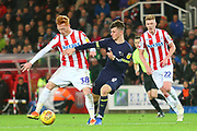 Stoke City's Ryan Woods (38) and Derby County midfielder Mason Mount (8) during the EFL Sky Bet Championship match between Stoke City and Derby County at the Bet365 Stadium, Stoke-on-Trent, England on 28 November 2018.