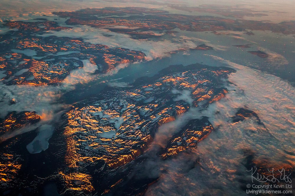 Mountains and fjords reach into the Davis Strait in the North Atlantic in this aerial view of the Western Greenland coast near Kangeq.
