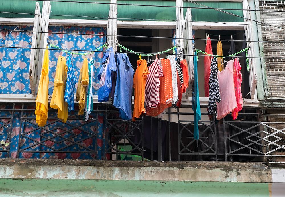 YANGON, MYANMAR - CIRCA DECEMBER 2013: Typical balcony in the streets of Yangon