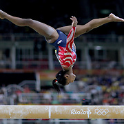 Gymnastics - Olympics: Day 2   Simone Biles #391 of the United States performing her routine on the Balance Beam during the Artistic Gymnastics Women's Team Qualification round at the Rio Olympic Arena on August 7, 2016 in Rio de Janeiro, Brazil. (Photo by Tim Clayton/Corbis via Getty Images)