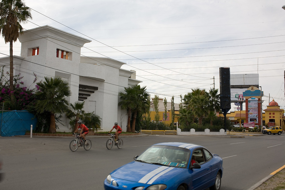 .Cyclist pass the former site of Auroma in Juarez Mexico of Saturday, Oct. 10, 2009..