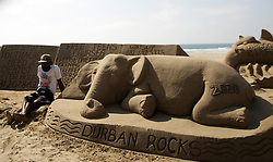 """South Africa - Durban - 02 August 2020 - Sanele Magcabe, 34 of KwaMashu, Durban sits next to his sand sculptures hoping to get a few """"shillings"""" from beach goers. Picture: Bongani Mbatha/African News Agency(ANA)"""