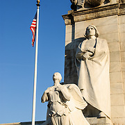 The statue of Christopher Columbus and winged figure representing Discovery at the Columbus Fountain. The Columbus Fountain, located in the plaza outside the main entrance to Union Station in Washington DC, was erected in 1912. At its center is a 45-foot shaft depicting the prow of a ship. A 15-foot high statue of Christopher Columbus gazes south towards the U.S. Capitol Building. A winged figurehead depicts Discovery, and other statues represent the Old and New Worlds. The fountain is constructed from marble, its sculptor was Lorado Z. Taft, and the architect Daniel H. Burnham.