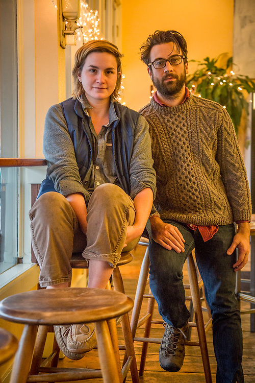 """""""I love Phillip but I'm terribly allergic to his cat...I'm waiting for her to die.""""  Allyson Makuch with Phillip Campanile escape the wet cool weather at Roasters Coffee in Calistoga."""