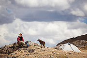 Charlie Bloch relaxes with his dog Arlo at camp above Parika Lake, Never Summer Wilderness, Colorado.