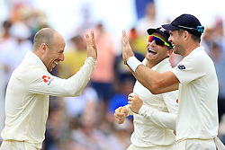 November 9, 2018 - Galle, Sri Lanka - England cricketers Jack Leach, James Anderson and  Jos Butler celebrate after taking a wicket during the 4th day's play of the first test cricket match between Sri Lanka and England at Galle International cricket stadium, Galle, Sri Lanka. 11-09-2018  (Credit Image: © Tharaka Basnayaka/NurPhoto via ZUMA Press)