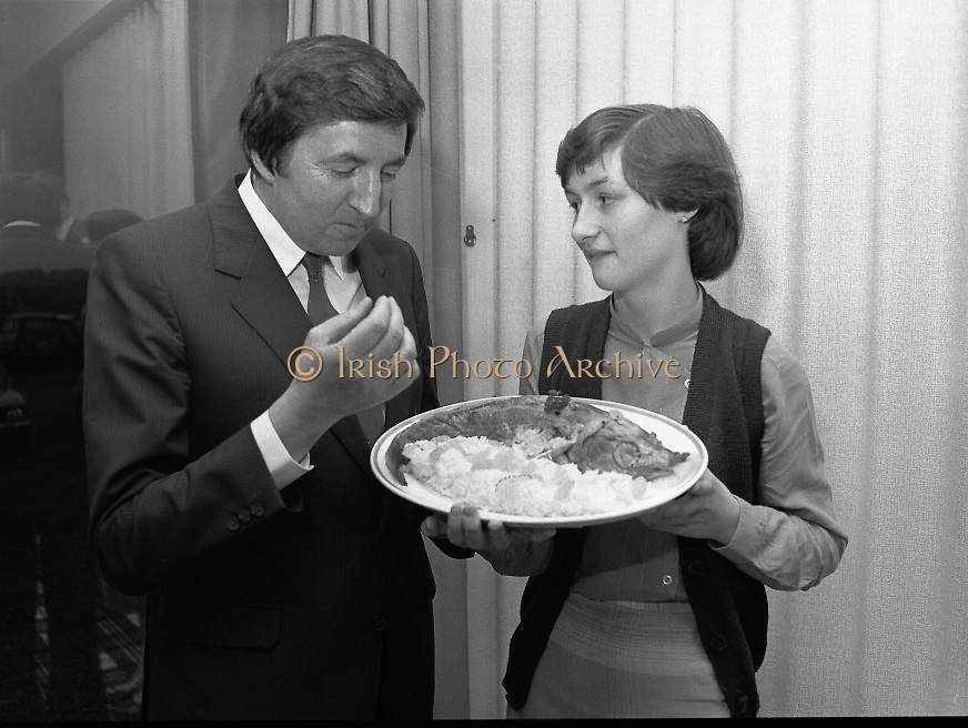 """""""The National Fish Cookery Award""""..29.04.1982..04.29.1982.29th April 1982.1982..This competition sponsored by Bord Iascaigh Mhara was held in The Clare Inn, Newmarket-on Fergus,Co Clare. the competition was open to schools across the country..Minister Daly samples the winning entry with its creator Catherine O'Sullivan."""