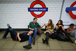 © Licensed to London News Pictures. 20/08/2016. London, UK. Tube passengers wait for a night tube service of Central line at Oxford Circus station in London for the first time on 20 August 2016. Transport for London started a 24-hour Tube service on Victoria and Central lines as demand has soared over recent years, with passenger numbers on Friday and Saturday nights up by around 70 per cent since 2000. The plan was announced in November 2013 and intended to begin in September 2015, but strikes over pay delayed the start by nearly another year. Photo credit: Tolga Akmen/LNP