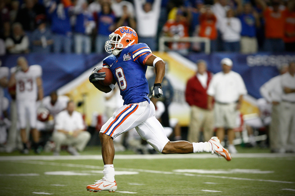 Florida RB Percy Harvin runs for a 67 yard TD during the SEC Championship game between the Arkansas Razorbacks and the Florida Gators at the Georgia Dome in Atlanta, GA on December 2, 2006.<br />