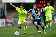 Carl Magnay of Hartlepool United (l) and Michael Harriman of Wycombe Wanderers compete for the ball. Skybet football league two match, Wycombe Wanderers v Hartlepool Utd at Adams Park in High Wycombe, Bucks on Saturday 5th Sept 2015.<br /> pic by John Patrick Fletcher, Andrew Orchard sports photography.