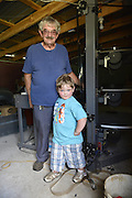 The Kings Drive In movie in Russelville Alabama Jimmy Greenhill owner and his grandson Weston Gregory Greenhill,5 yrs old, get ready for the Saturday Drive In Friday July 12,2013. <br /> Artist Eugenia Summer at home Saturday July 13,2013,Columbus MS.© Suzi Altman/TheOneMediaGroup