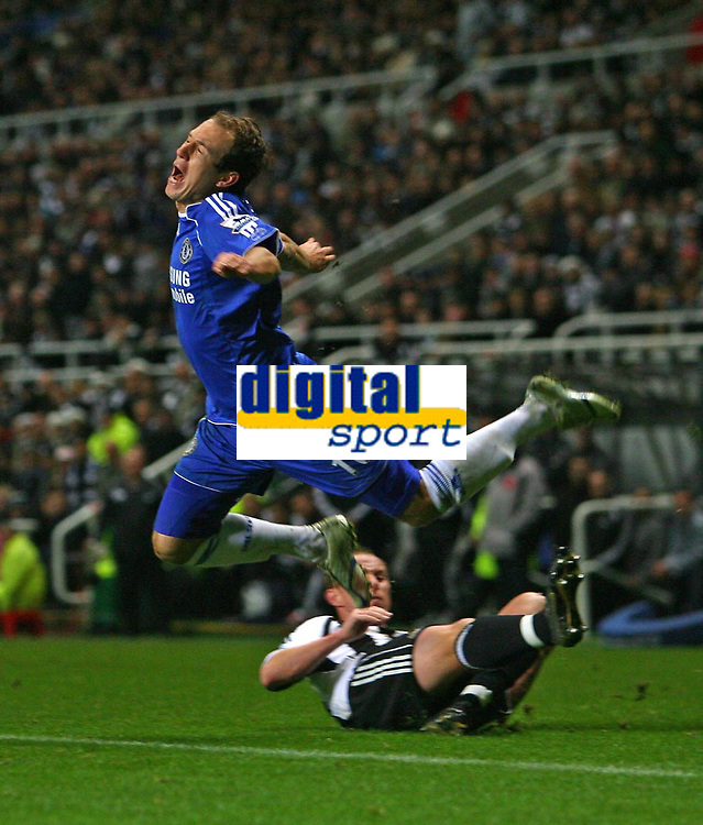 Photo: Andrew Unwin.<br /> Newcastle United v Chelsea. Carling Cup. 20/12/2006.<br /> Chelsea's Arjen Robben (L) is fouled by Newcastle's Nicky Butt (R).