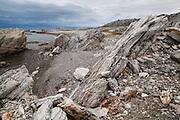 The rocky shoreline of Hyttevika, Svalbard.