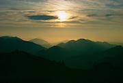 The sun setting over theSalzkammergut mountain range, Austria