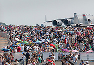 New Windsor, New York - Crowds gather during the second day of the New York Air Show at Stewart International Airport on Aug. 30, 2015. Aircraft on static display are in the background.