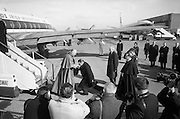 Cardinal Conway William is greeted in the customary manner by An Taoiseach Sean Lemass on his return from Rome where he had been elevated to the cardinalate..02.03.1965