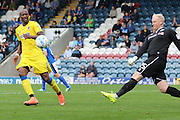 AFC Wimbledon striker Tom Elliott (9) closes in on Rochdale FC goalkeeper Conrad Logan (25) during the EFL Sky Bet League 1 match between Rochdale and AFC Wimbledon at Spotland, Rochdale, England on 27 August 2016. Photo by Stuart Butcher.