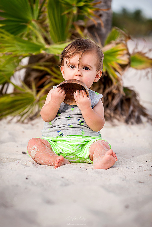 During a family shoot the little one explors the world around him on Sombrero Beach in Marathon, Florida.