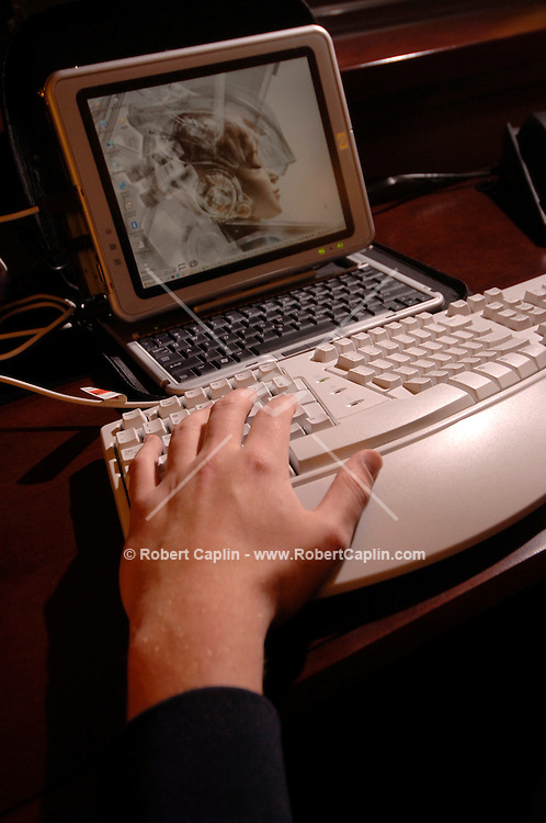 Amal Graafstra demonstrates how he logs into his computer using the chip implanted in this hand. The receiver is in the keyboard.