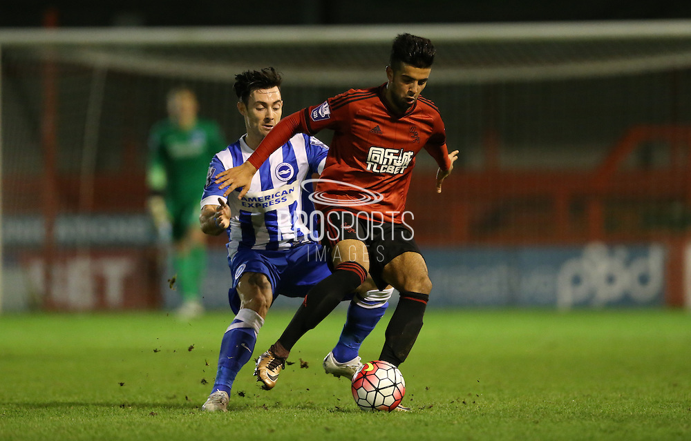 Rahis Nabi, West Bromwich Albion midfielder fends off Richie Towell, Brighton striker during the Barclays U21 Premier League match between Brighton U21 and U21 West Bromwich Albion at the Checkatrade.com Stadium, Crawley, England on 25 January 2016.