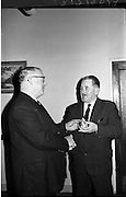 07/02/1964<br /> 02/07/1964<br /> 07 February 1964<br /> Esso staff presentations in Esso premises at Alexandra Road, Dublin. Presentation of watch by Mr Denis Dunne (left), Director at Esso Petroleum Company (Ireland) Ltd.